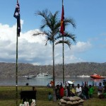 14 September 2014 Centenary Service for AE1 in Rabaul. HMAS Yarra visible in harbour