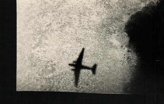 DC3 shadow on edge of coral reef