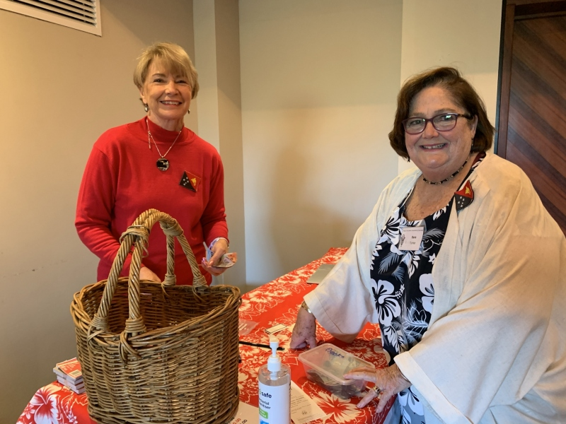 Cheryl Marvell and Sara Turner organise the raffle - with funds assisting the PNGAA Collection.